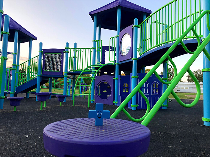 A close up shot of a new playground.